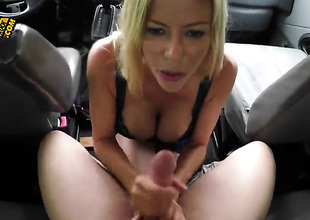 Oral by a busty blonde in the SUV