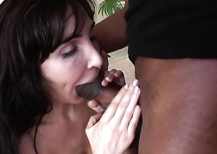 Brunette Diana Prince can not resist the temptation to take heavy money shot on her face